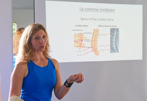 Laura talks about the lumbar spine during the Mend My Back Workshop